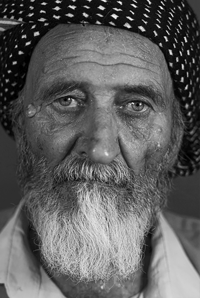 An elderly man from Iraq with a Kurdish nation without a person sleep